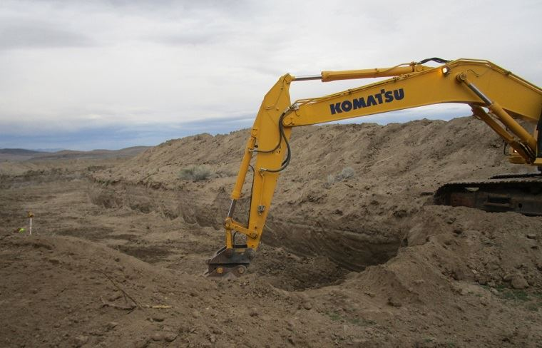 Excavator digs a large trench in the desert around Fallon to channel flood water to the Stillwater R